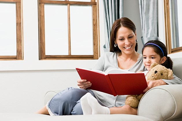 Woman reading to young girl